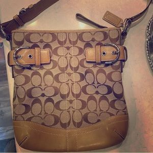 Coach Purse w/ buckles and zippers like new